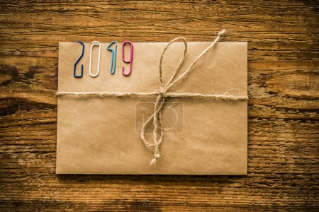 2019 number form colorful clips on paper envelope on wooden table