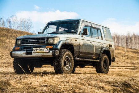 MOSCOW, RUSSIA - APRIL 05, 2015 : Truck car on offroad ,adventure trail. Dirty and muddy 4x4 vehicle details during off road race. toyota land cruiser