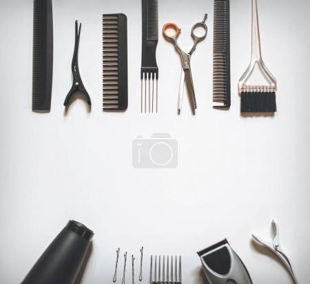 Hair stylist's accessories on a white background top view copy space. Hairdressing skill. Barbershop concept.