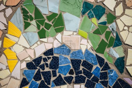 Mosaic wall decorative ornament from ceramic broken tiles, decorative ornament. Colorful wall background.