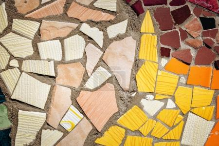 Photo for Mosaic wall decorative ornament from ceramic broken tiles, decorative ornament. Colorful wall background. - Royalty Free Image