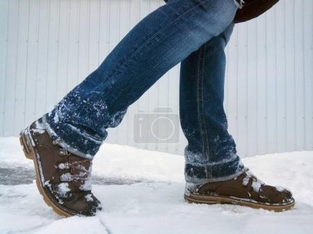 Winter shoes in the snow. Walking on snow. Danger of slipping on ice