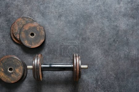 Workout concept background with old dumbbell, home...