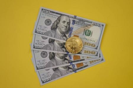 Golden bitcoin and money