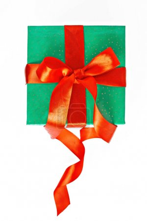 red and green Christmas gift with ribbon isolated