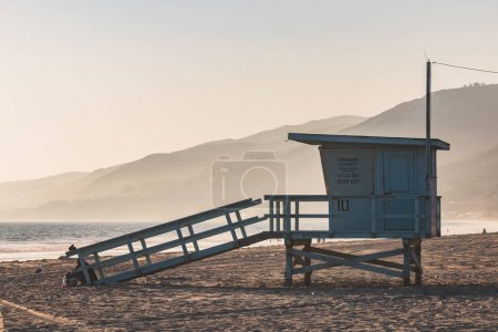 A lifeguard station with a foggy background and mo...
