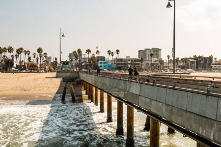 People Enjoy a Visit to Venice Beach Fishing Pier in Southern California
