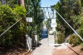 SAN DIEGO, CALIFORNIA - APRIL 28, 2017:  The entrance to the Spruce Street Suspension Bridge built in 1912 by the City of San Diego, designed by Edwin Capps, it is 375 feet long and 70 feet high.