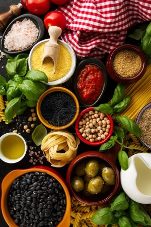 Photo for Food background Food Concept with Various Tasty Fresh Ingredients for Cooking. Italian Food Ingredients. View from Above. - Royalty Free Image