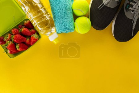 Healthy Life Sport Concept. Sneakers with Fruits, Towel and Bottle