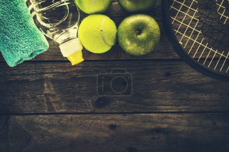 Photo for Healthy Life Sport Concept. Sneakers with Apples, Towel and Bottle of Water on Wooden Background. Copy Space. - Royalty Free Image