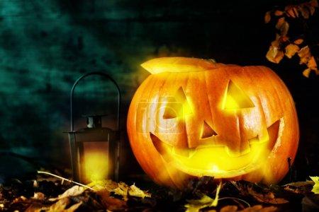 Pumpkin with lantern on dark background