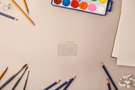 Photo for From above set of different pencils and drawing colors palette on beige background. - Royalty Free Image