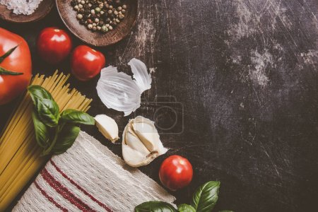 Foto de Top view of different vegetables and products for pasta making on rough table. - Imagen libre de derechos