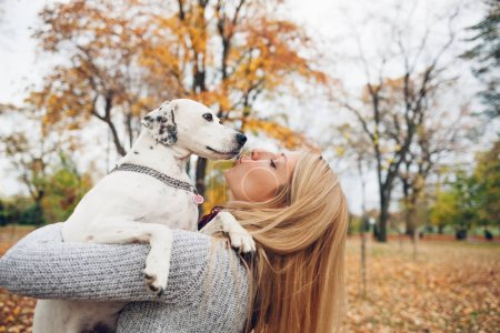 Woman with a dog in park