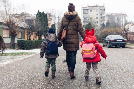 Mom walking with children