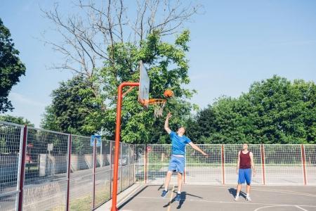 Men playing basketball outdoor