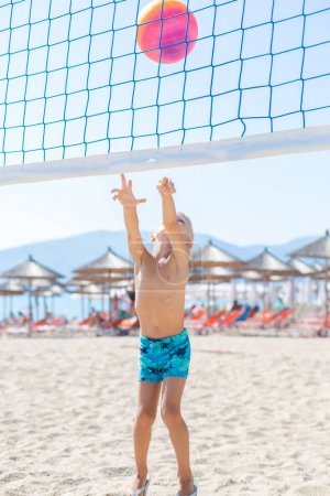 boy playing Beach Volleyball