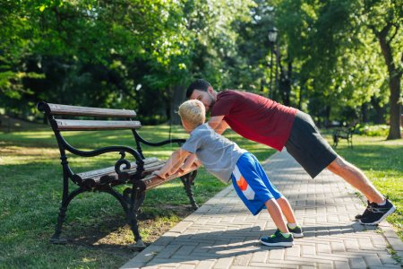 Father and son workout in the park