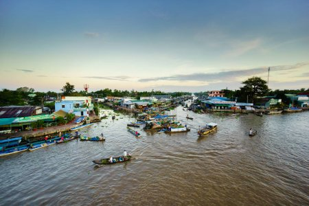 Nga Nam Floating Market, Soc Trang, Vietnam - Nov 22, 2014: Nga Nam floating market in early morning. Nga Nam market is the convergent point of five rivers which flow into five different directions.