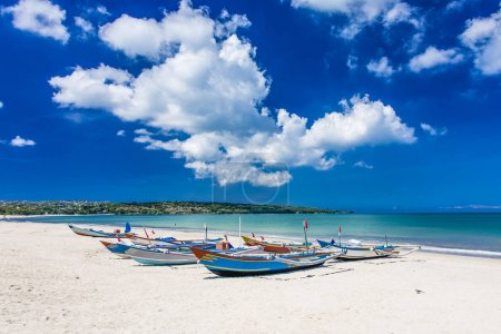 Photo for Traditional Bali fishing boats grounded on Jimbaran Beach - Royalty Free Image