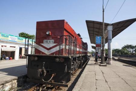 Passengers preparing to catch diesel train