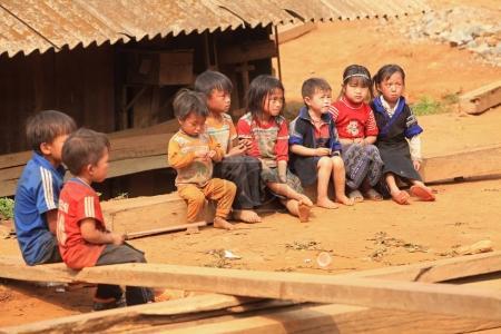 children sitting on wooden beams