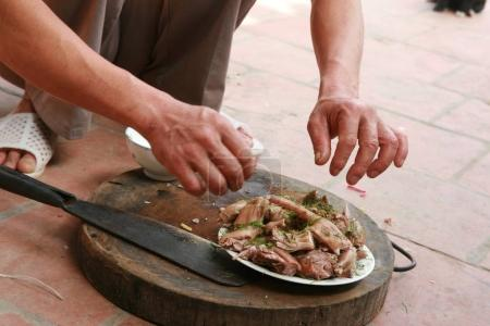 person serving rat pieces on plate