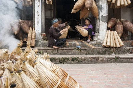 masters making bamboo handicraft products