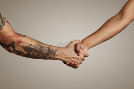 Handshake of two muscular men's hands