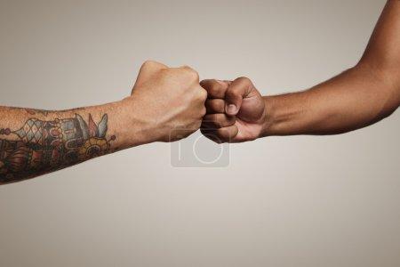 Friends do a fist bump