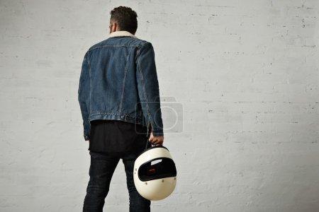 motor biker walking away