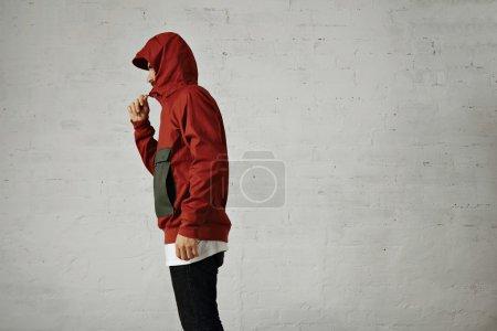 man zips up his fashionable anorak