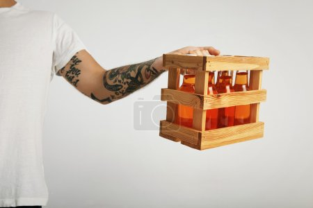 delivery man holding crate with cider