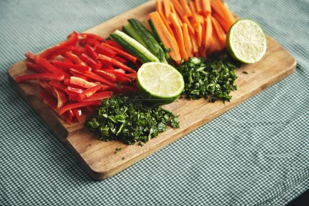 Cut fresh vegetables on a wooden board