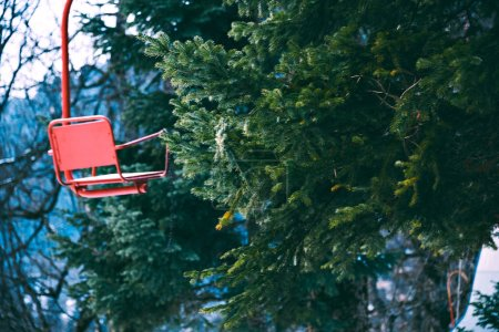 Old vintage ski lift with colorful chairs