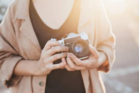 Woman holds vintage camera