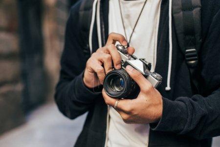 Man holding vintage analog camera