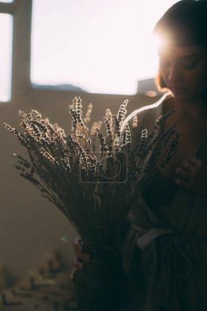 woman holding lavender bouquet