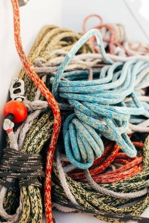 close up of Running and rigging of nautical marine ropes pile on yacht