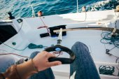 Professional sailor person holding paddle on yacht boat