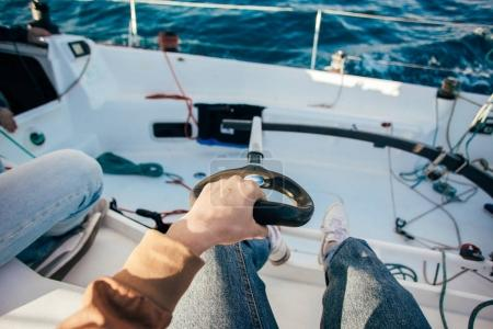 person holding paddle on yacht