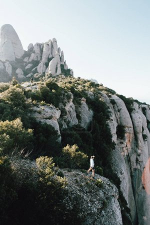 Tiny figure or athlete, adventurer, runner or sportsman in middle of amazing epic landscape with mountains and cliffs around, national park nomad lifestyle, travel inspiration