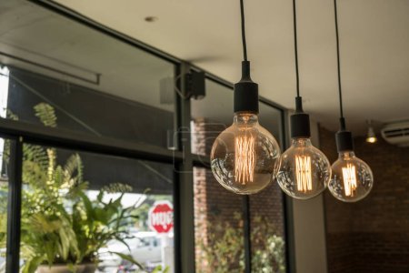 Photo for Light bulb in coffee shop background. innovation and idea concept. - Royalty Free Image