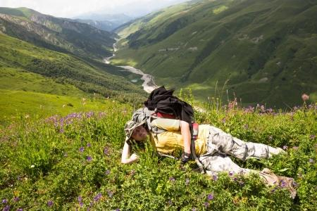 Happy hiker relax on beautiful mountains landscape