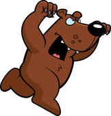 A cartoon bear running to attack with claws out