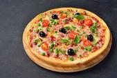 Pizza tarantella on the chalk board with copy space