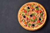 Pizza tarantella on the chalk board with copy space, flat lay