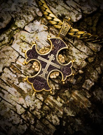 gold cross on a tree bark christianity, smutty