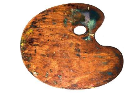 Photo pour Palette en bois de l'art réel avec des blobs de peinture et un pinceau sur fond blanc. Concept Art et artisanat - image libre de droit